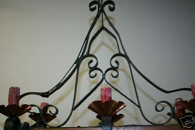 A  French wooden/wrought-iron 6 light castle chandelier 7